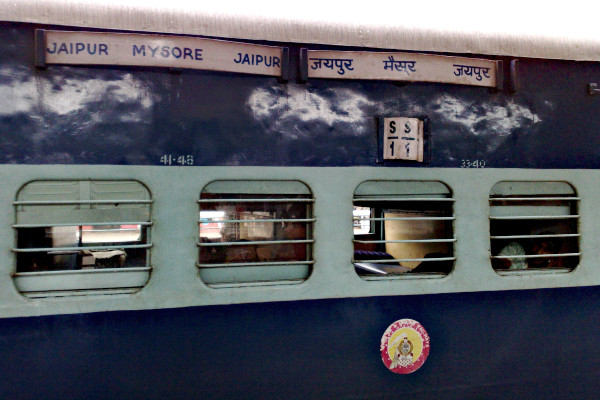 A sleeper coach of the Jaipur - Mysore Express train.