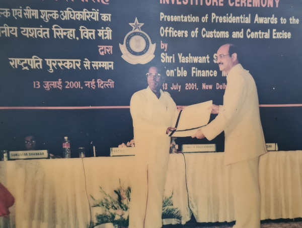 Guru Receiving Meritorious Award