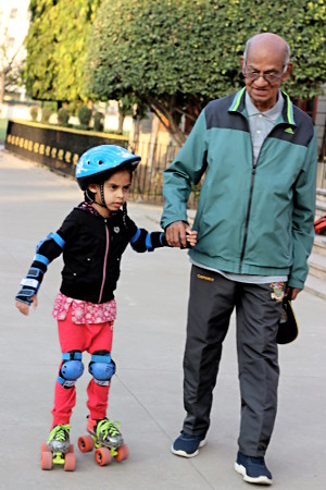 Father Mani with a young skater.
