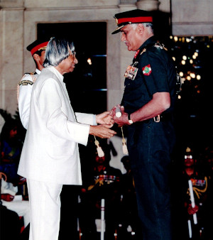 Major General Raj Mehta receiving an award for distinguished service in a war zone from the President on Republic Day.