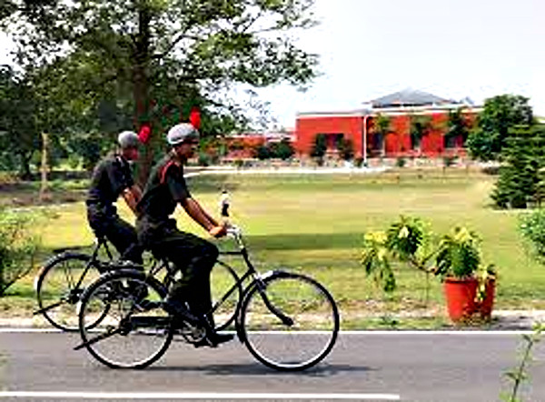 Gentlemen Cadets using bicycles to get around on the campus at the Indian Military Academy (IMA), Dehradun.