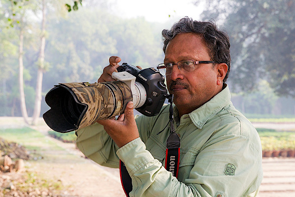 Vinod Goel with a camera by Canon